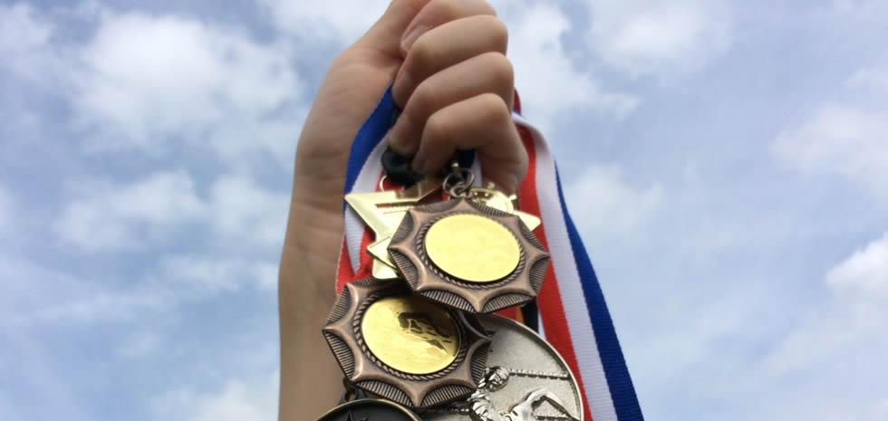 Kendal Mint medals